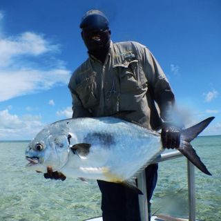 Whitney with a Nice permit on the flats flats East Grand Bahama.