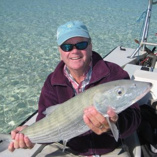 Kevin with one of many big bonefish he caught with Whitney .