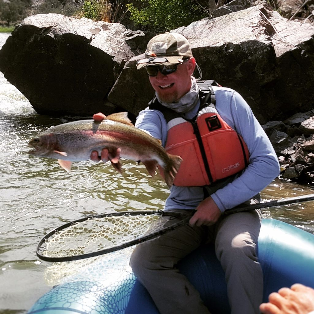 Action angler fly fishing outfitter fly dreamers directory for Fly fishing outfitters
