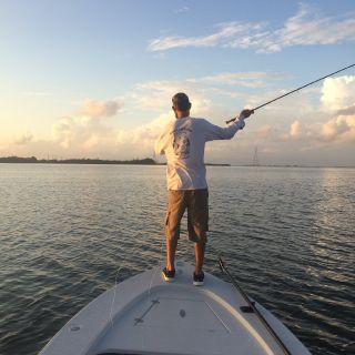 Casting to a pod of tarpon that we could see pushing a wake at first light.