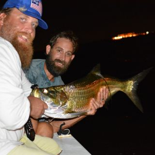 My good friend Adam with a nice mid sized tarpon we sight fished on a recent night trip around Tampa Bay.