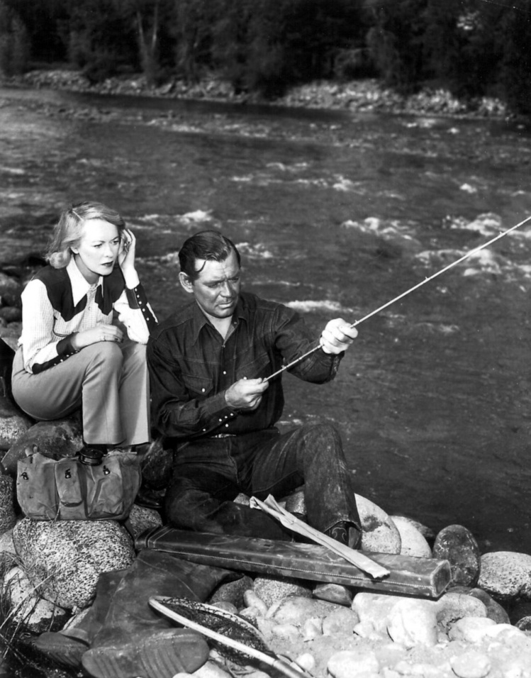 Clark Gable fly fishing with his  wife Sylvia Ashley