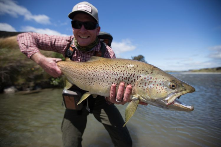 Client Tim (WA OZ)  Fiordland Trophy Brown Trout bottomed the 14lb scales. The biggest wild fish caught to date by my client South Island  New Zealand Guide: Chris Reygaert