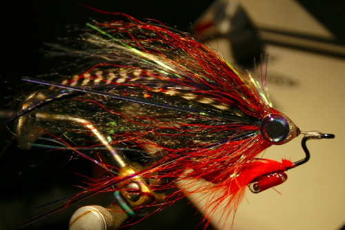 Once I stumbled over this flypattern, I immediately fell in love. Not only is it fun to tie and looks amazing in the water, the fish really love to hit it. But I hate to loose a fly, which took some time to tie, to a stupid branch or other kind of weed. Looking at some spinning Lures with a worm hook inside, I decided to try the same system with a fly. As this pattern is hollow it was just perfect for this application. This pattern is under constant development, but for the moment im pretty satisfied with it. I can fish it trough Lili pads, fish it through a sunken tree with a sinking line or cast it directly into the reed without loosing a fly. You might miss some strikes, but still you are going to hook 3 out of 5 while fishing in waters you normally couldn't even fish a meter without snagging something. And this is with european pike which don't bite that hard sometimes. The stronger/aggressive the fish is, the better the hook up ratio will be.